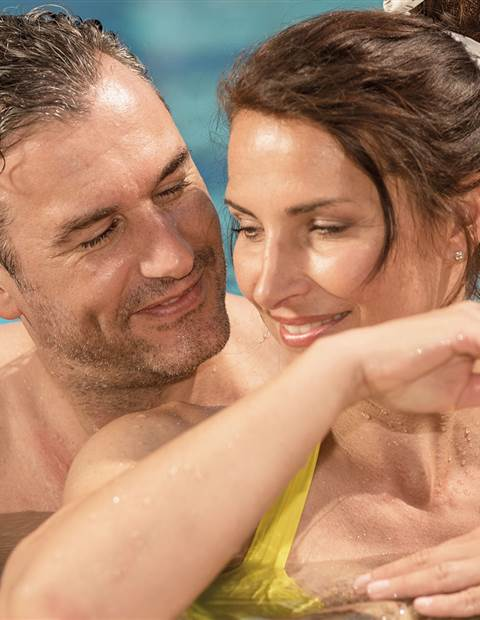 Couple in a hotel pool in detail