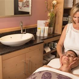 Woman receives facial massage at a hotel