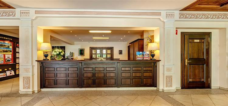 Hotel lobby with reception area in wooden look