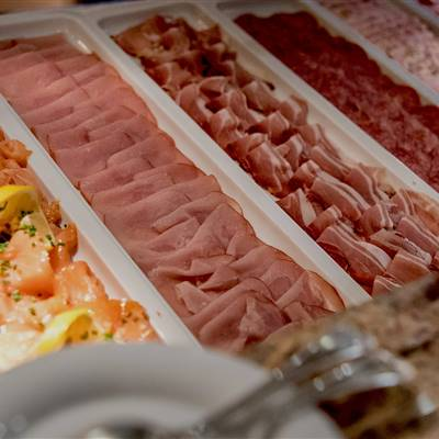 Selection of sausages and salmon at breakfast buffet in detail