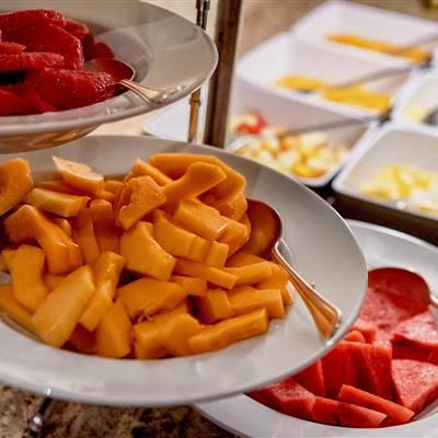 Cut fruits at a breakfast buffet