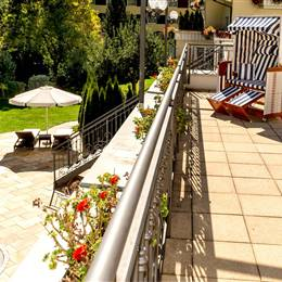 Hotel terrace with outdoor pool in summer
