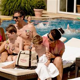 Family relaxes in a hotel pool