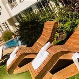 Sun loungers on a hotel sunbathing lawn