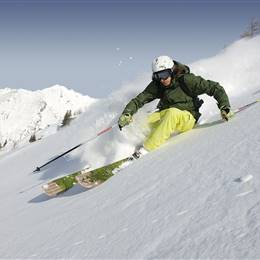 Skier off-piste in deep snow
