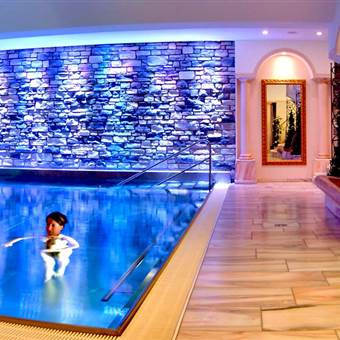 Wellness area with indoor pool in a hotel at night
