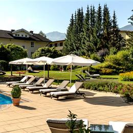 Hotel with outdoor pool and loungers with sunshades