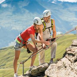 Couple in climbing equipment on a via ferrata