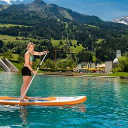 Girl on a SUP on a swimming lake