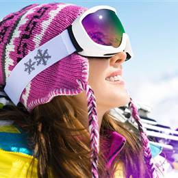 Skier with ski goggles in sunshine at close-up